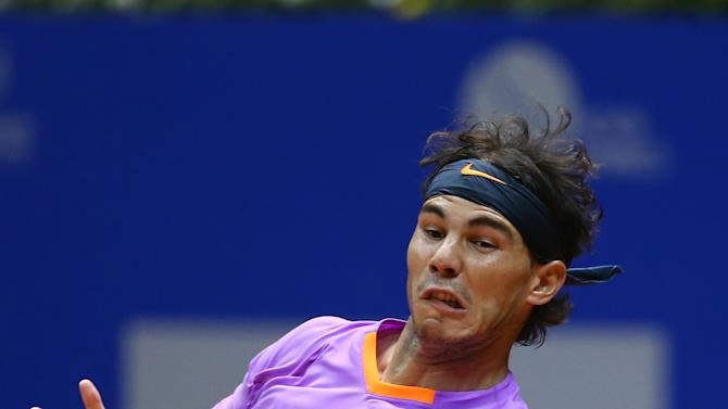 Spain's Rafael Nadal returns the ball to Argentina's David Nalbandian during the Brazil Open ATP tournament final match in Sao Paulo, Brazil, Sunday, Feb. 17, 2013. (AP Photo/Andre Penner)