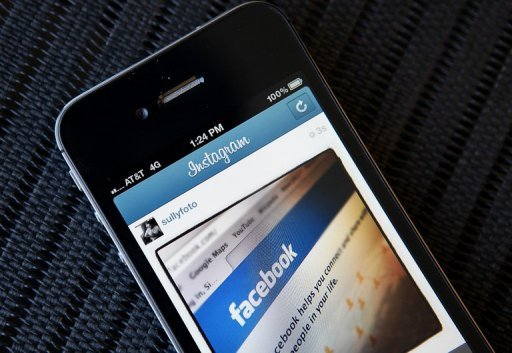 An Instagram photo of the Facebook website app is seen on an Apple iPhone
