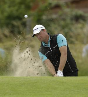 Peter Hanson of Sweden chips a shot out of a bunker onto the first green at Royal Lytham & St Annes golf club during the third round of the British Open Golf Championship, Lytham St Annes, England, Saturday, July 21, 2012. (AP Photo/Jon Super)