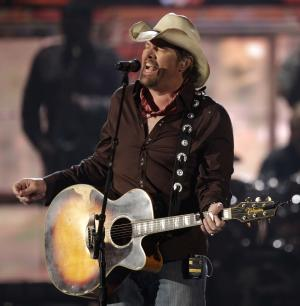 FILE - In this April 3, 2011 file photo, country singer Toby Keith performs at the 46th Annual Academy of Country Music Awards in Las Vegas. (AP Photo/Julie Jacobson, file)