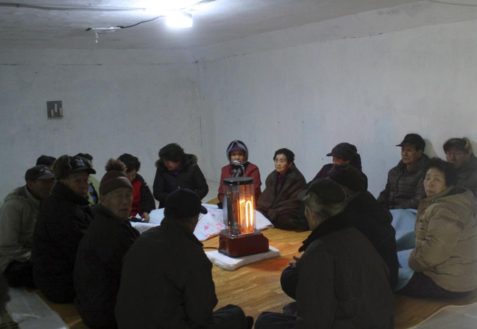 South Korean residents gather in an underground shelter on Baengnyeong Island, as South Korea  began live-fire military drills from front-line islands near its disputed sea border with North Korea, despite Pyongyang's threat to attack, Monday, Feb. 20, 2012, in South Korea.  (AP Photo/Yonhap) KOREA OUT
