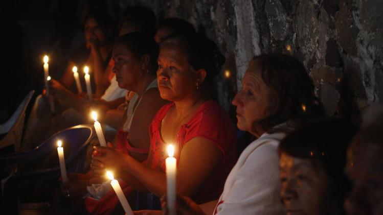 ... Edgar Tamayo hold candles outside Tamayo family house in Miacatlan