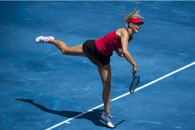 Maria Sharapova from Russia serves the ball to Serena Williams from U.S.  during the Madrid Open tennis tournament, in Madrid, Friday, May 11, 2012. (AP Photo/Daniel Ochoa de Olza)