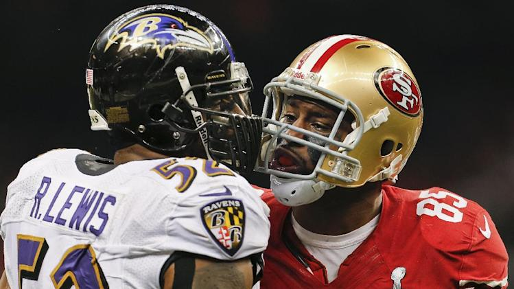 Baltimore Ravens linebacker Ray Lewis (52) exchanges words with San Francisco 49ers tight end Vernon Davis (85) in the second quarter of the NFL Super Bowl XLVII football game, Sunday, Feb. 3, 2013, in New Orleans. (AP Photo/Julio Cortez)