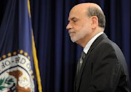 <p>US Federal Reserve chief Ben Bernanke arrives for a news conference in Washington, DC, on September 13. The US Federal Reserve took aim at slow growth and high joblessness, announcing a new, open-ended $40 billion per month bond-buying program as it slashed its 2012 growth forecast.</p>