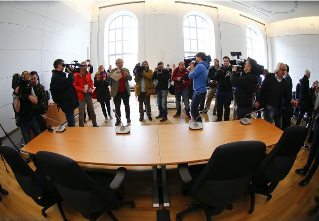 Journalists film the dock inside the courtroom of the Munich Landgericht, where Bayern Munich's President Uli Hoeness will stand trial, in Munich