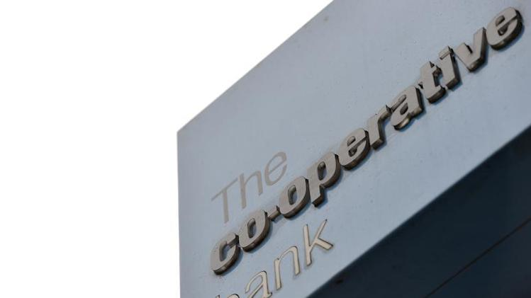 A sign is seen outside a branch of the Co-operative Bank in central London