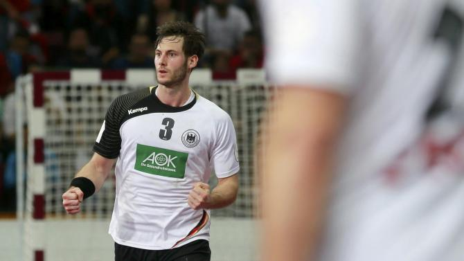 Gensheimer of Germany celebrates his goal against Egypt during their round of 16 match against Egypt at the 24th men's handball World Championship in Doha