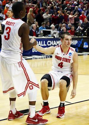 NCAA upsets mark first full day of NCAA tournament