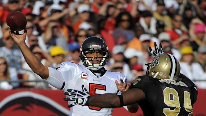 Tampa Bay Buccaneers quarterback Josh Freeman (5) fires a pass as New Orleans Saints defensive end Cameron Jordan (94) pressures him during the second quarter of an NFL football game, Sunday, Oct. 16, 2011, in Tampa, Fla. The Buccaneers won 26-20. Freeman threw for 303 yards and two touchdowns. (AP Photo/Brian Blanco)