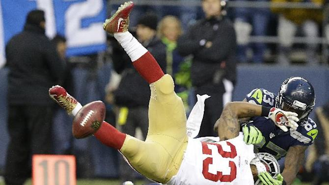 San Francisco 49ers' LaMichael James fumbles as he is hit by Seattle Seahawks' Ricardo Lockette (83) on a kick off during the first half of the NFL football NFC Championship game Sunday, Jan. 19, 2014, in Seattle. The 49ers recovered the fumble