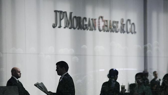People arrive at JPMorgan Chase headquarters in New York Monday, May 14, 2012. JPMorgan, the largest bank in the United States, is seeking to minimize the damage caused by a $2 billion trading loss, disclosed Thursday by CEO Jamie Dimon. (AP Photo/Mark Lennihan)