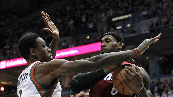 Miami Heat forward LeBron James, right,is pressured by Milwaukee Bucks center Larry Sanders (8) during the first quarter of Game 4 in a first-round NBA basketball playoff series in Milwaukee, Sunday, April 28, 2013. (AP Photo/The Miami Herald, Al Diaz) MAGS OUT