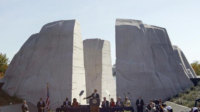 FILE - In this Oct. 16, 2011, file photo, President Barack Obama speaks at the dedication of the Martin Luther King Jr. Memorial in Washington. Monday's inaugural may be Obama's big day, but Martin Luther King Jr. will loom large over the festivities. A quirk in the calendar pushed Obama's public swearing-in onto the national holiday honoring the slain civil rights leader, and inaugural planners have taken pains to acknowledge that fact. Going into his second term, Obama seems to have put King at the front of his mind, too.  (AP Photo/Charles Dharapak)