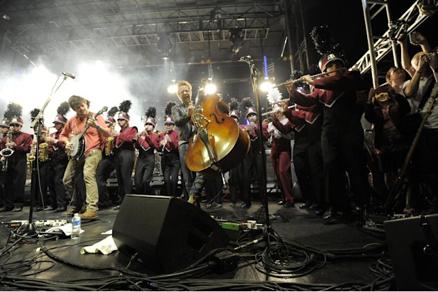 Mumford &amp; Sons performs with the Austin High Marching Band at the Myspace Big Easy Express concert at SXSW in Austin, Texas, Saturday, March 17, 2012. (Jack Dempsey/AP Images for Myspace)