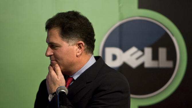 FILE - In this Thursday, March 26, 2009, file photo, Michael Dell, Chairman and CEO of Dell Inc., reacts to a question during a press conference in Beijing, China.  Slumping personal computer maker Dell announced Tuesday, Feb. 5, 2013, it is bowing out of the stock market in a $24.4 billion buyout that represents the largest deal of its kind since the Great Recession dried up the financing for such risky maneuvers. billion. Michael Dell, who owns nearly 16 percent stake in the company, will remain the CEO after the sale closes and will contribute his existing stake in Dell to the new company. (AP Photo/Alexander F. Yuan, File)