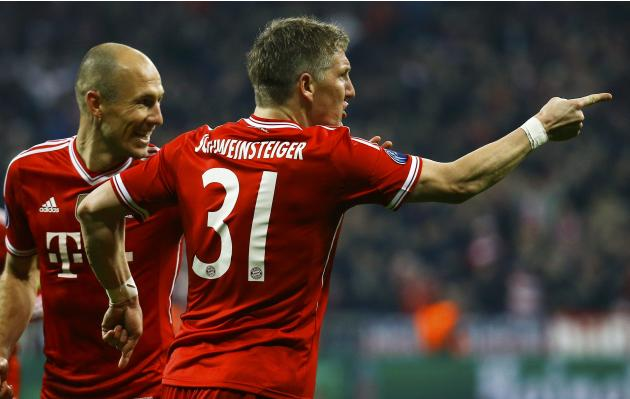 Bayern Munich's Schweinsteiger celebrates with Robben after scoring a goal against Arsenal during their Champions League round of 16 second leg soccer match in Munich