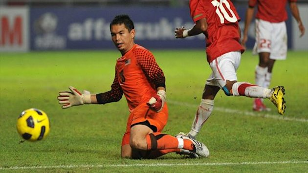 Goalkeeper Mohamad Sharbinee Allawe, in action for Malaysia against Indonesia in 2010 (AFP)