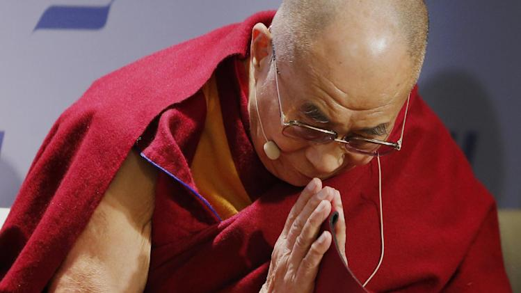 "Tibetan spiritual leader the Dalai Lama acknowledges the audience before speaking at an event entitled: ""Happiness, Free Enterprise, and Human Flourishing"" Thursday, Feb. 20, 2014, at the American Enterprise Institute in Washington. (AP Photo/Charles Dharapak)"