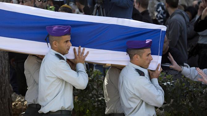 Israeli soldiers carry the coffin of Major Yochai Kalangel during his funeral in Jeruslaem, Thursday, Jan. 29, 2015.  Israeli Prime Minister Benjamin Netanyahu on Thursday said that Iran is to blame for a deadly flare-up along the Israeli-Lebanese border the previous day, the deadliest escalation in the disputed zone since the 2006 war between Hezbollah and Israel.(AP Photo/Sebastian Scheiner)