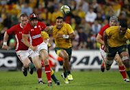 Leigh Halfpenny (second-left) of Wales kicks the ball against Australia during their rugby union match at Suncorp Stadium in Brisbane on June 9. Australia defeated Six Nations champions Wales 27-19 in the first of three Tests