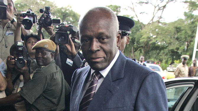 FILE - An April 12, 2008 photo from files showing Angola's President Jose Eduardo dos Santos arriving at the Mulungushi International Conference Center in Lusaka, Zambia. Angola's second election in 20 years will test the popularity of dos Santos after a decade of peace that has brought much prosperity to the country rich in oil and diamonds though more than a third of citizens still live in abject poverty. (AP Photo/Themba Hadebe, File)