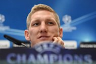 Bayern Munich midfielder Bastian Schweinsteiger addresses a press conference on the eve of the UEFA Champions League second leg semi-final match between Real Madrid and Bayern Munich in Madrid, Spain