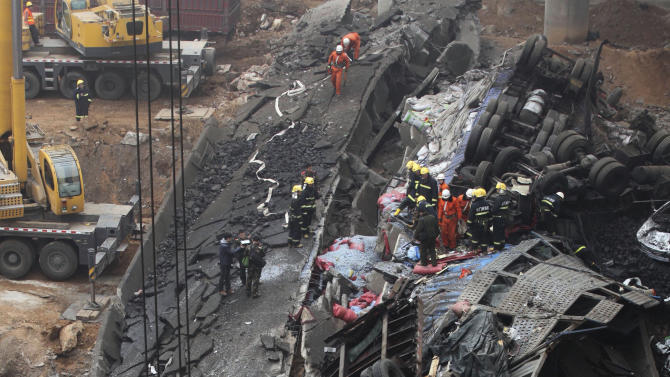 Rescuers work at the accident site where an expressway bridge partially collapsed due to a truck explosion in Mianchi County, Sanmenxia, central China's Henan Province, Thursday, Feb. 1, 2013. A truckload of fireworks intended for Lunar New Year celebrations went off Friday in a massive, deadly explosion that destroyed part of an elevated highway in central China, sending vehicles plummeting 30 meters (about 100 feet) to the ground. (AP Photo)