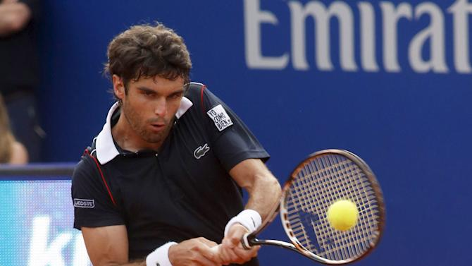 Pablo Andujar of Spain returns a ball to Kei Nishikori of Japan during the Barcelona Open tennis tournament in Barcelona
