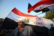 &lt;p&gt;Supporters of Egypt&#39;s military council, who oppose the newly elected president Mohamed Morsi, rally against the reinstatement of parliament near the tomb of the late president Anwar al-Sadat in Cairo on July 9. Parliament was in legal limbo Wednesday after a top court overruled a presidential decree reinstating the dissolved house, stepping up a power struggle between the president and army.&lt;/p&gt;