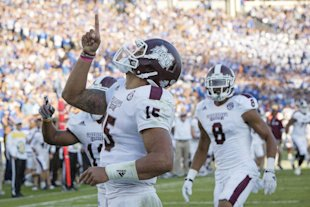 Dak Prescott and Mississippi State sit atop the first version of the College Football Playoff rankings. (AP)