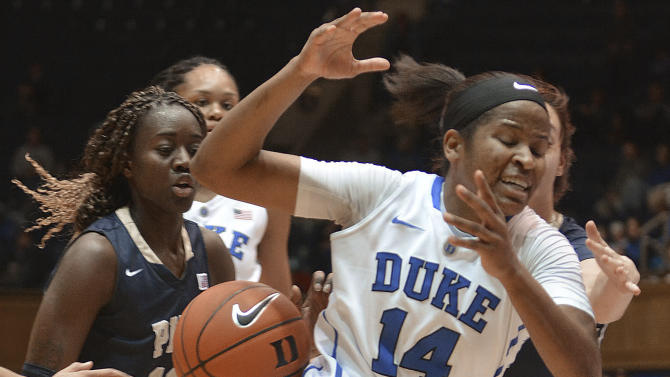 Duke's Ka'lia Johnson (14) loses the ball as Pittsburgh's Yacine Diop (12) and Monica Wignot, right, defend during an NCAA college basketball game Thursday, Jan. 29, 2015, in Durham, N.C. (AP Photo/The Herald-Sun, Bernard Thomas)