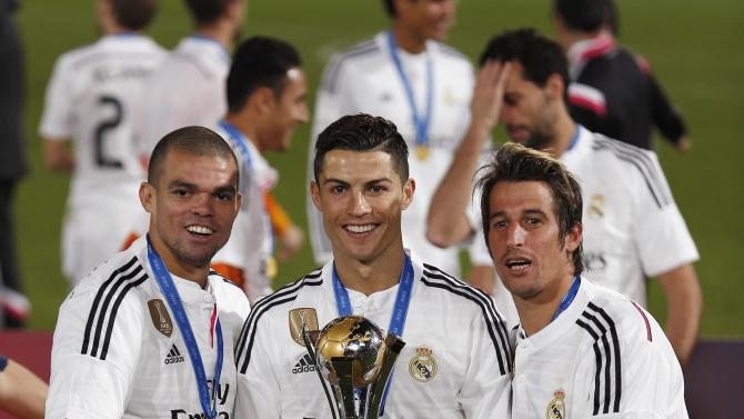 Real Madrid's Ronaldo, Pepe and Fabio Coentrao pose with the trophy after winning the Club World Cup final soccer match against San Lorenzo at Marrakesh