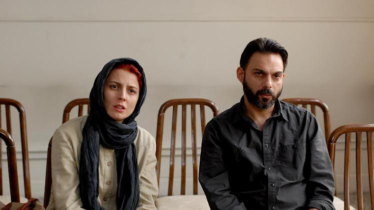 "FILE - In this publicity film image released by Sony Pictures Classics, Leila Hatami, left, and Peyman Moadi are shown in a scene from ""A Separation."" (AP Photo/Sony Pictures Classics, Habib Madjid, Filei)"
