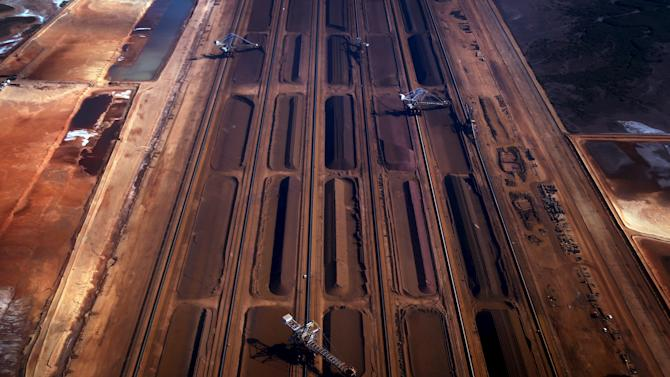 File photo of bucket-wheel reclaimers moving iron ore at a loading terminal in the town of Port Hedland