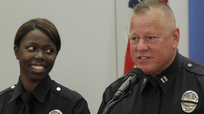 Husband and wife, Sgt. Emada Tingirides and Capt. Phil Tingirides speak during a news conference Tuesday Feb. 19, 2013 in Los Angeles. The couple discussed the issue of racism in the LAPD. Capt. Phil Tingirides, headed the three-person disciplinary panel that unanimously decided Christopher Dorner should be fired for making a false report. The family's six kids plus a daughter's boyfriend were under police protection for six days. (AP Photo/Nick Ut)