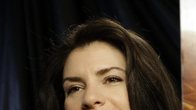 """This Feb. 19, 2013 photo shows author Stephenie Meyer in Miami. Meyer, author of the """"Twilight"""" saga says she's working on a new series.  She wrote """"The Host"""" as an escape from editing of one of the books in the popular vampire series. The movie adaption of """"The Host"""" premieres March 29. (AP Photo/Alan Diaz)"""