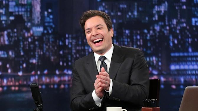 """This Feb. 21, 2013 photo released by NBC shows Jimmy Fallon, host of """"Late Night with Jimmy Fallon,"""" on the set in New York. As Jay Leno lobs potshots at ratings-challenged NBC in his """"Tonight Show"""" monologues, speculation is swirling the network is taking steps to replace the host with Jimmy Fallon next year and move the show from Burbank to New York.  NBC confirmed Wednesday, March 20, it's creating a new studio for Fallon in New York, where he hosts """"Late Night."""" But the network did not comment on a report that the digs at its Rockefeller Plaza headquarters may become home to a transplanted, Fallon-hosted """"Tonight Show.""""  (AP Photo/NBC, Lloyd Bishop)"""