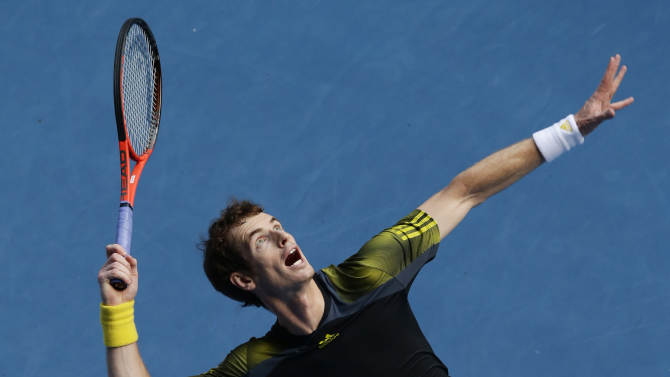Britain's Andy Murray serves to France's Gilles Simon during their fourth round match at the Australian Open tennis championship in Melbourne, Australia, Monday, Jan. 21, 2013. (AP Photo/Andy Wong)