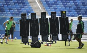 A Mexico soccer team assistant moves a training wall…