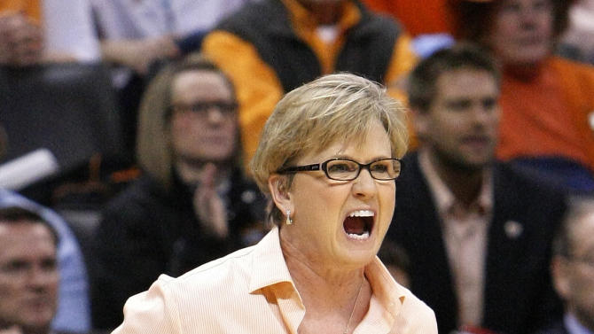 Tennessee coach Holly Warlick yells to her team as it plays Louisville during the first half of the Oklahoma City regional final in the NCAA women's college basketball tournament in Oklahoma City, Tuesday, April 2, 2013. (AP Photo/Alonzo Adams)