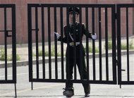 A paramilitary police officer closes the gate outside the U.S. embassy in Beijing