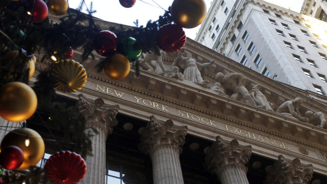 The facade of the New York Stock Exchange is framed by the NYSE holiday tree, Thursday, Dec. 20, 2012. Shares in the company that runs the New York Stock Exchange are surging amid reports that it is in talks to sell itself to a rival stock exchange, Atlanta-based IntercontinentalExchange Inc. (AP Photo/Richard Drew)