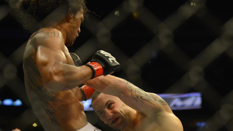 Benson Henderson from Arizona, lef6,  and Frankie Edgar from New Jersey fight in their middleweight title bout during UFC 150 in Denver, Saturday, Aug. 11, 2012. Henderson won the title bout. (AP Photo/Jack Dempsey)
