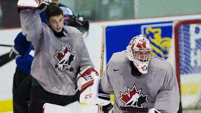 Team Canada goalies Jake Paterson, right, and Zach Fucale, left, take part in practice during the start of world juniors selection camp in Toronto on Friday, Dec. 13, 2013