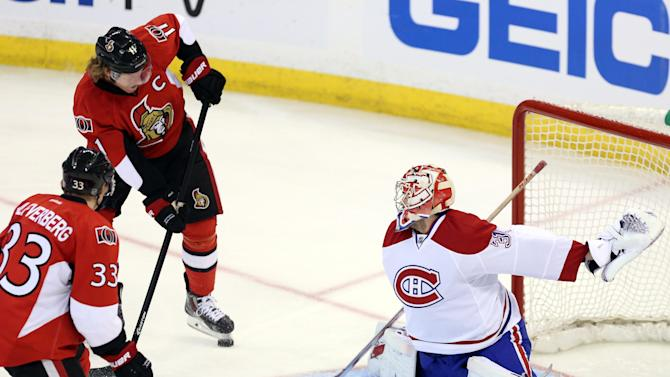 Ottawa Senators' Daniel Alfredsson gets ready to shoot the puck past Montreal Canadiens goaltender Carey Price (31) as Senators' Jakob Silfverberg (33) looks on during the first period of Game 3 of their first-round NHL hockey Stanley Cup playoff series, Sunday, May 5, 2013, in Ottawa, Ontario. (AP Photo/The Canadian Press, Fred Chartrand)