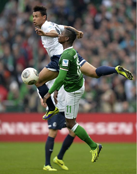 Freiburg's Francis Coquelin of France, top, and Bremen's Eljero Elia of the Netherlands challenge for the ball during the German first division Bundesliga soccer match between Werder Bremen and SC Fre