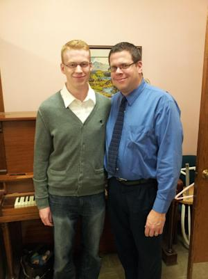 "This Nov. 2011 image released by Peter Wagner shows Jake Wagner,19, and his father Peter Wagner, of Buffalo, N.Y., at a baptism in Welland Ontario in Canada. Jake is a Republican and his father Peter is a Democrat. While young people have gone ""liberal"" on their conservative parents for decades, teen crossovers to the GOP are more of a rarity. (AP Photo/courtesy Peter Wagner)"