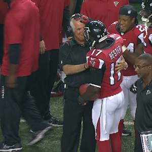 Atlanta Falcons coach Mike Smith and wide receiver Devin Hester share moment