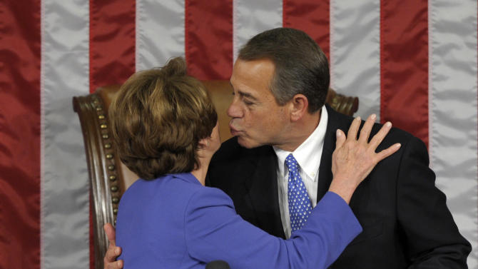 House Minority Leader Nancy Pelosi of Calif. gets a kiss from House Speaker John Boehner of Ohio after he was re-elected as House Speaker as the 113th Congress began, Thursday, Jan. 3, 2013, on Capitol Hill in Washington. (AP Photo/Susan Walsh)